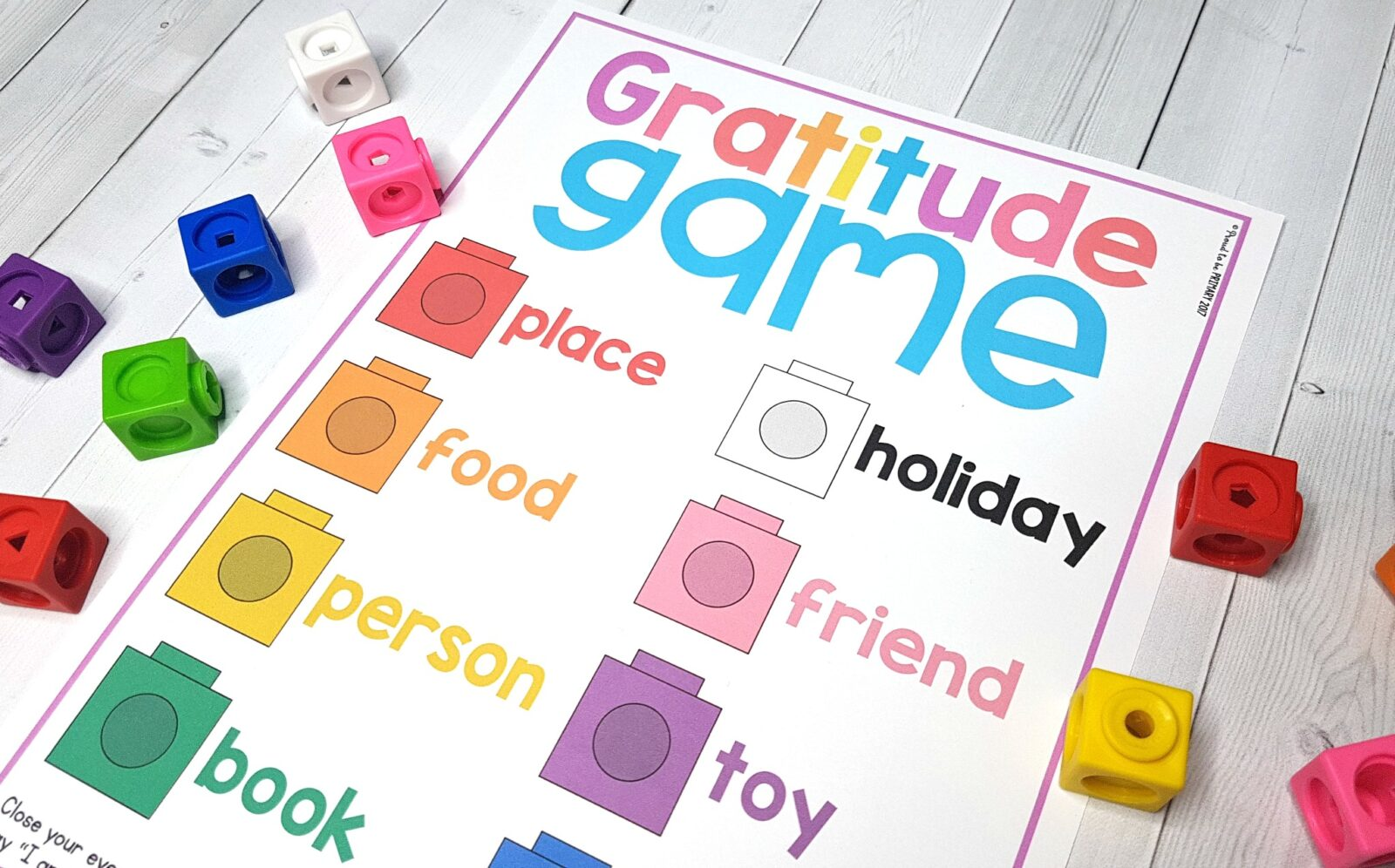 gratitude game printable with colored snap cubes on table