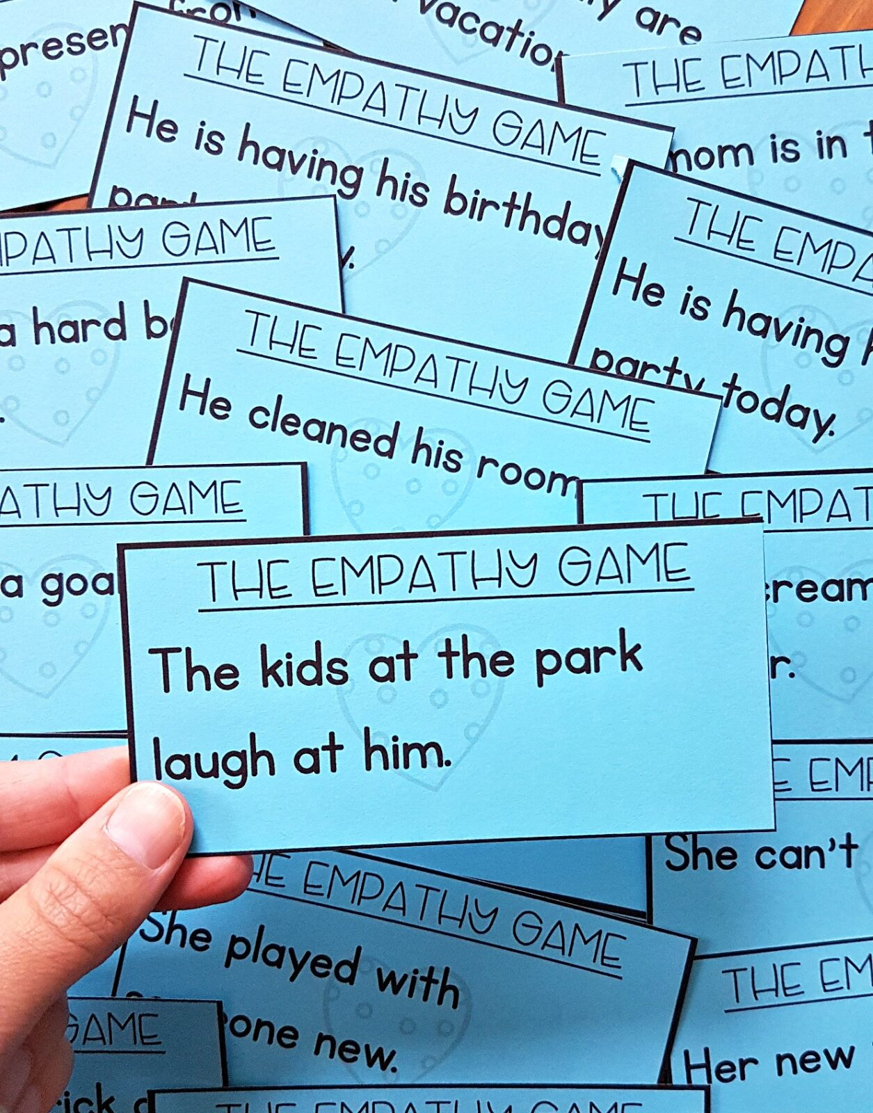 the empathy game for role playing with scenarios on cards for kids to relate to