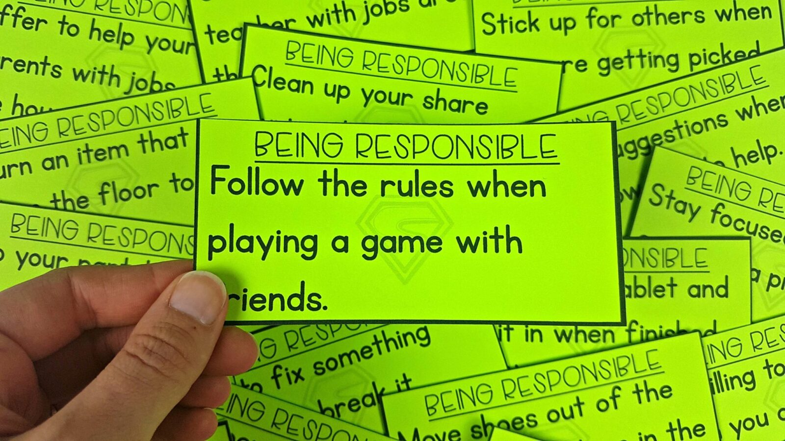 hand holding up card with being responsible scenarios