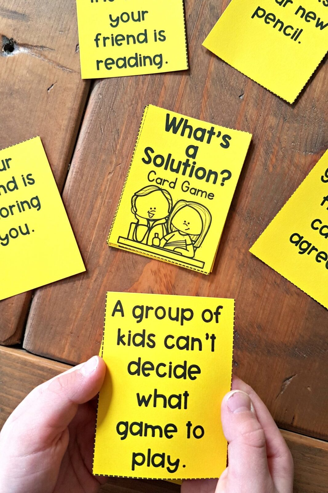 what's the solution card game on table with hands