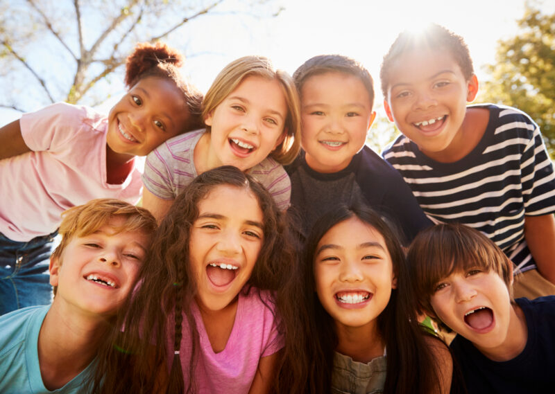 image of kids smiling in a group