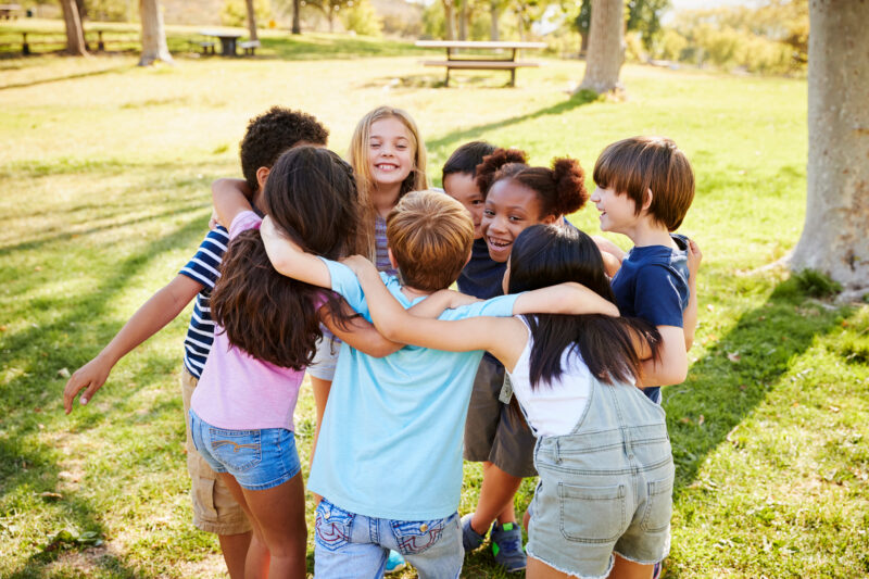 kids in a huddle - social-emotional learning activity