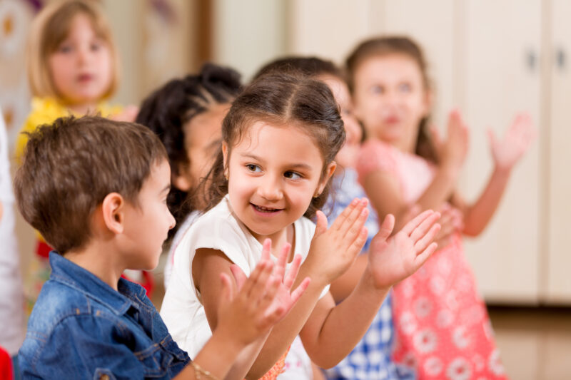 kids clapping together during a brain break activity